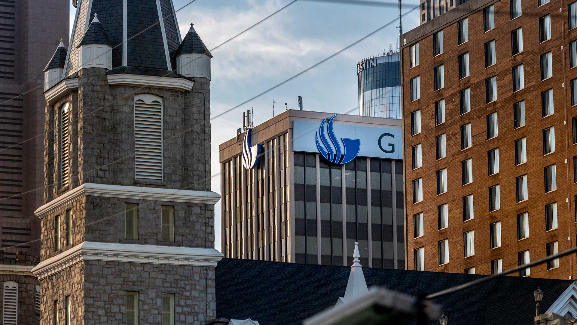 Downtown building tops with Georgia State flame on side of one