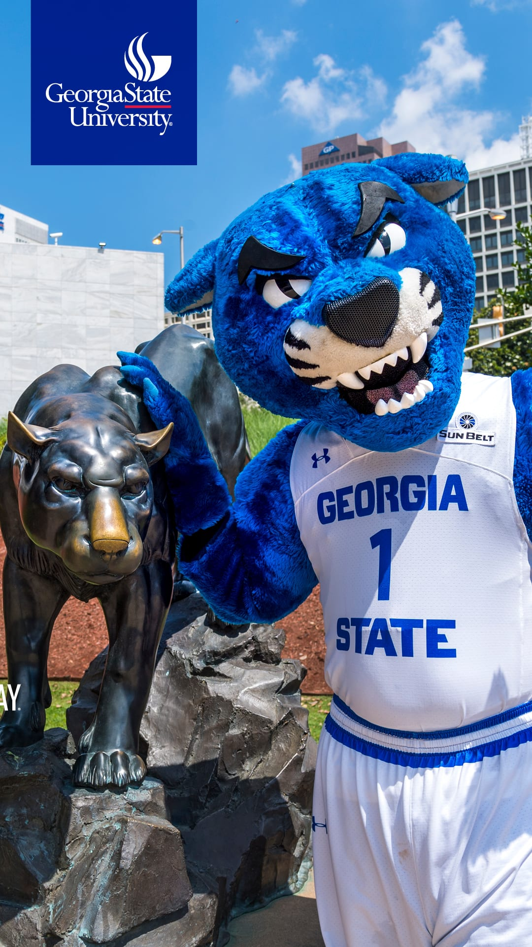 Pounce mascot beside bronze panther